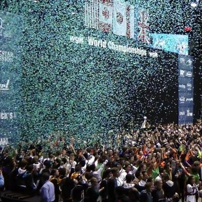 Championship celebration with huge clouds of confetti falling on everyone.