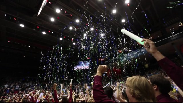 Huge  celebrations with shiny metallic streamers soaring high over the crowd.