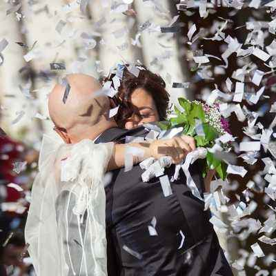 Beautiful wedding confetti on the happy couple