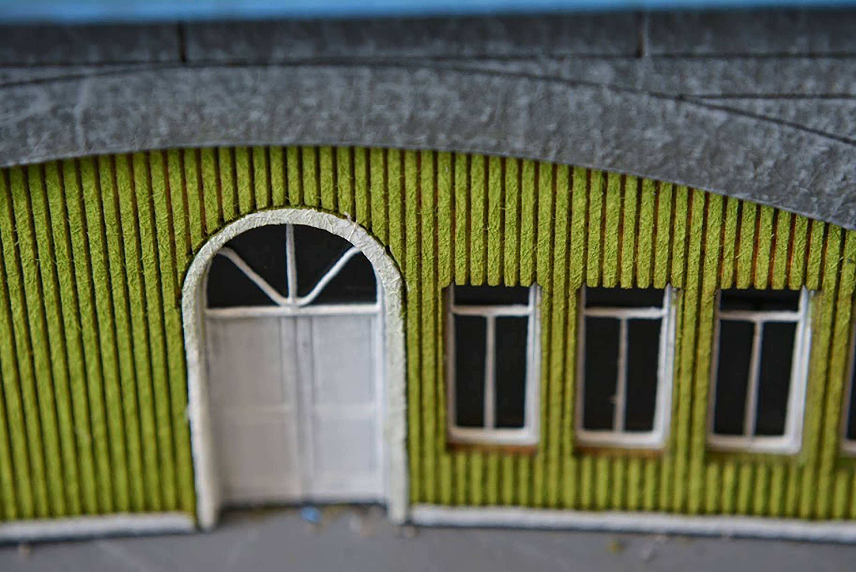 N scale railroad shed model in green