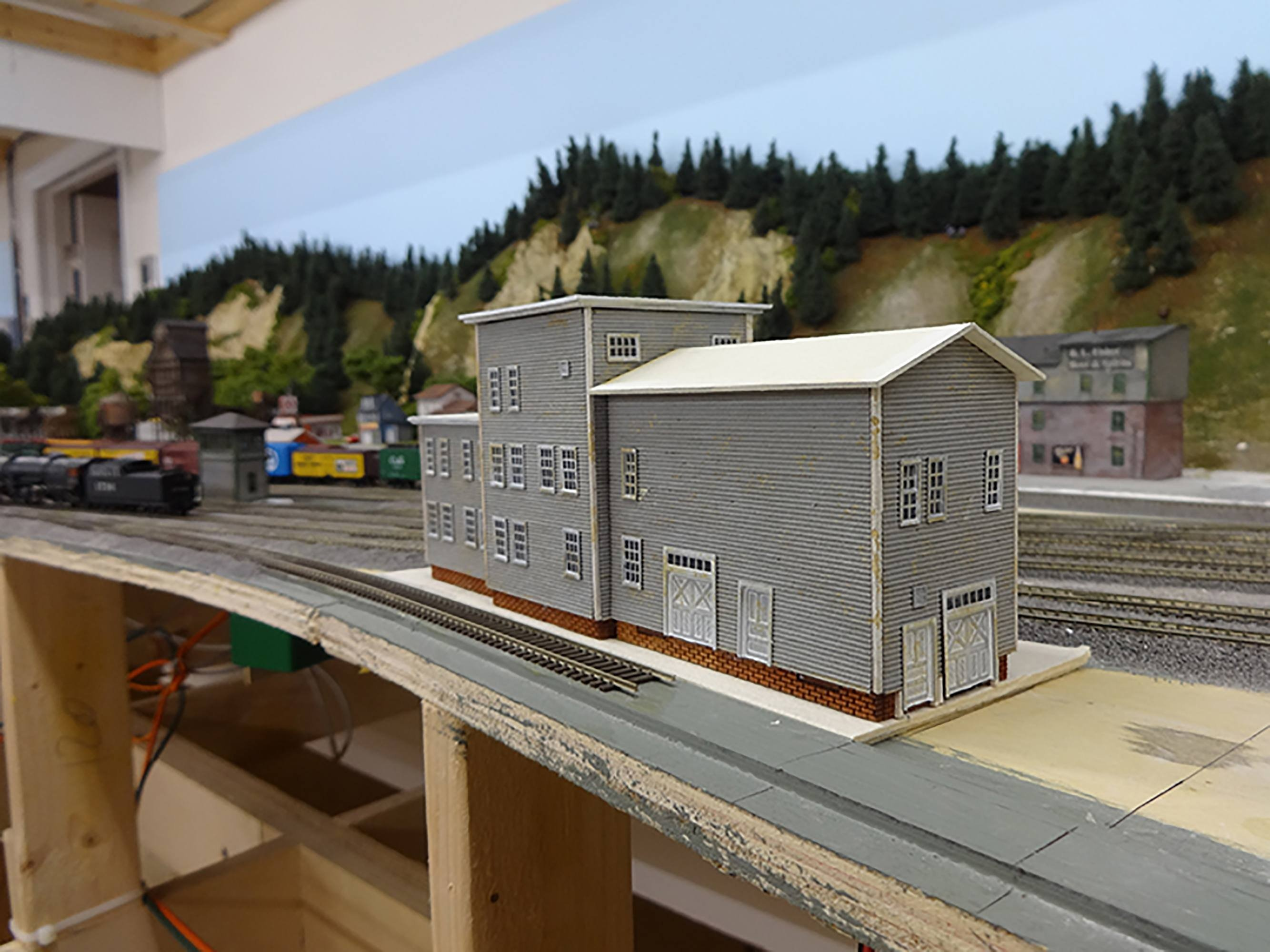 Scale railroad model gray building