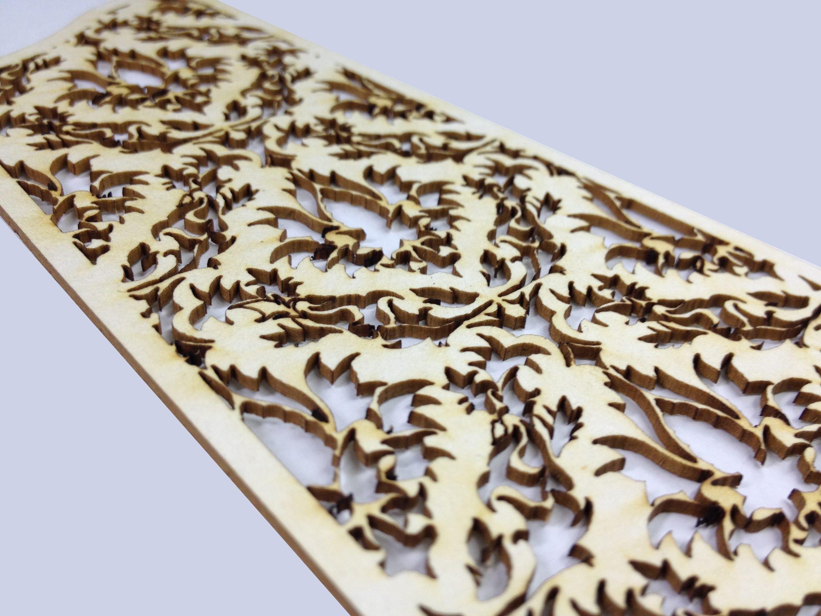 Intricate laser cut cardboard